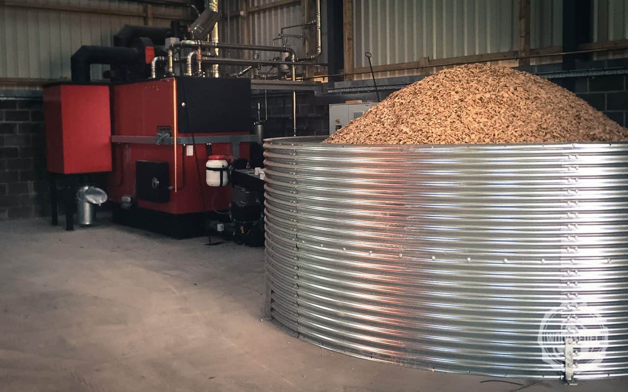Wood chip biomass tank with feed auger to the green energy boiler by Woodyfuel