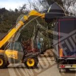 Wood chip load into the truck by excavator - bulk delivery by UK's fuel supplier